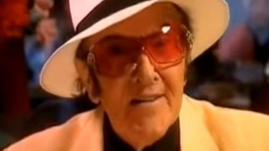 Eddy Wally begraven in witte kist en gouden lijkwagen
