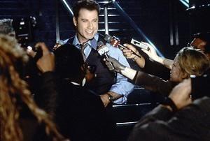 Travolta en Cage ruilen van gezicht