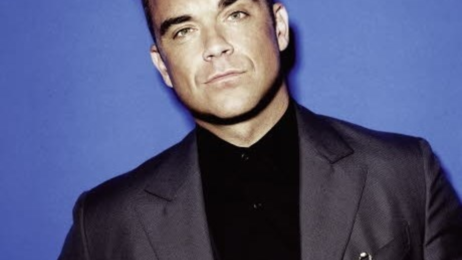 YouTube-hit: Robbie Williams zingt zoontje de wereld in