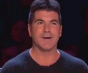Cheryl Cole bedreigt Simon Cowell